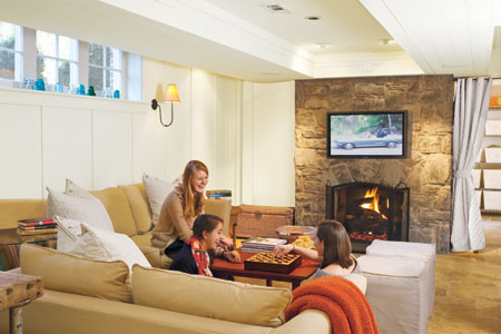 teens enjoying their basement turned family room