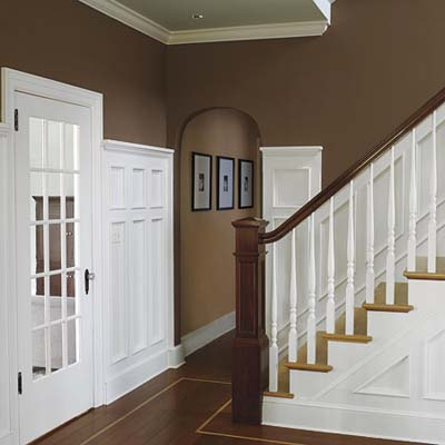 entryway hallway and stairwell with wainscotting