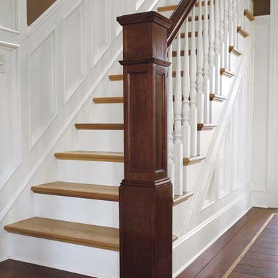 wooden stairwell with wainscotting
