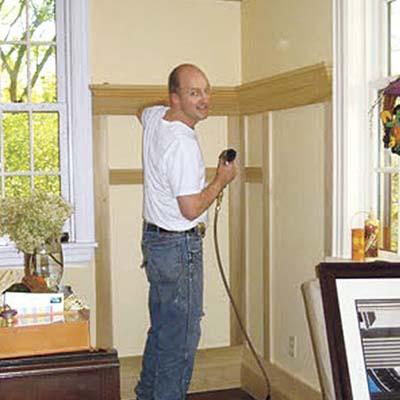 man installing wainscot panels