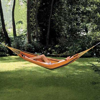 a woman in a hammock made by Texsport