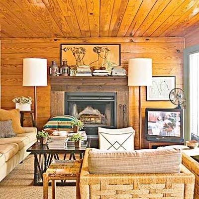 a family room made over to look like a lakeside cottage
