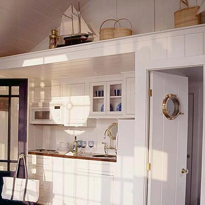 a kitchen area made over in a nautical style