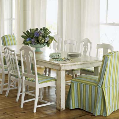 warm bright dining room table with fabric covered chairs in ample natural light