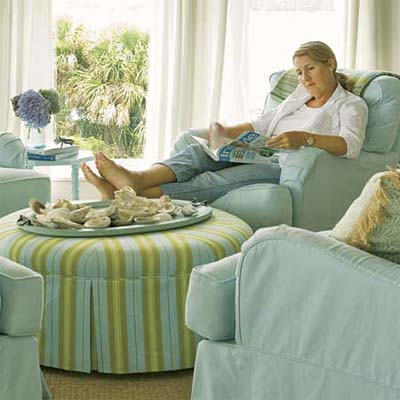home owner reading in a comfortable living room chair decorated in warm colors
