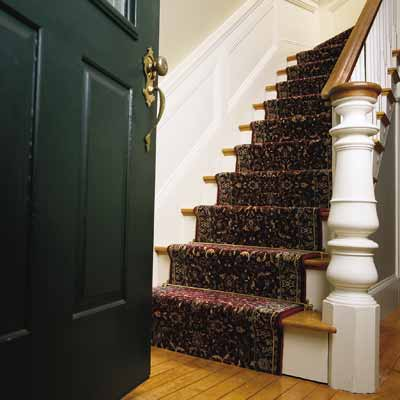 Attaching a stair runner to treads