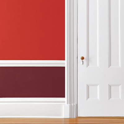room with million dollar red and raisin torte two toned walls
