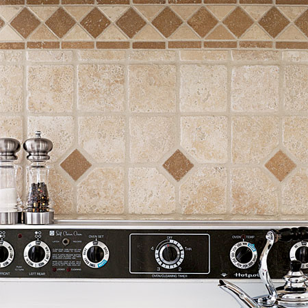 backsplash made with leftover tiles built into this budget remodeled custom kitchen