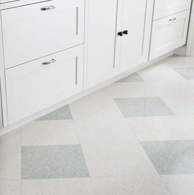 cafeteria style flooring and white cabinets
