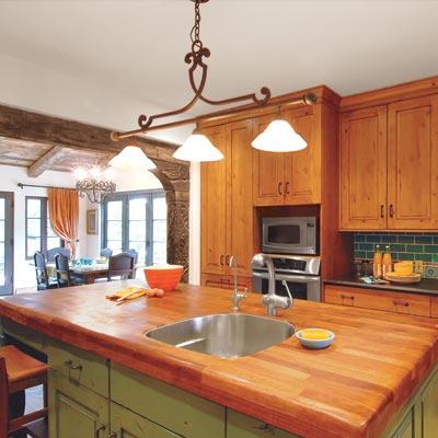 old world style kitchen with large island make of iroko wood