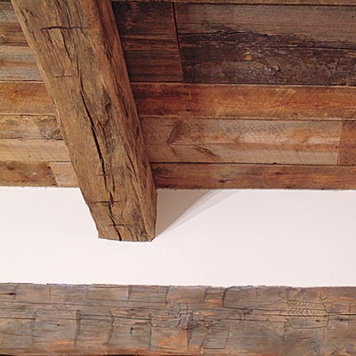 salvaged wooden beams in old world style kitchen