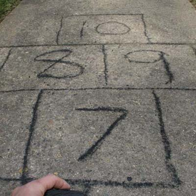 hopscotch court in driveway marked in charcoal