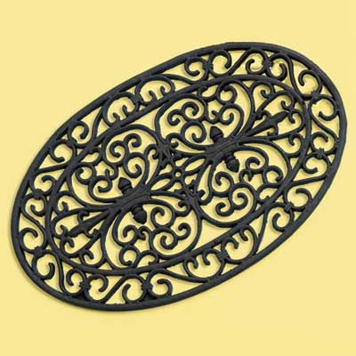 rubber doormat decorated to in a faux iron work design; welcome mat