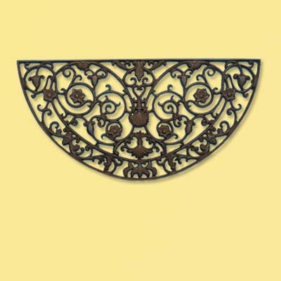 cast iron doormat in an ornate crescent shape; welcome mat