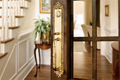 forged brass entry set in wood and glass interior door