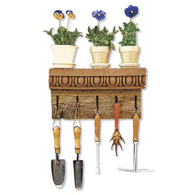 terracotta cornice used as a garden tool rack