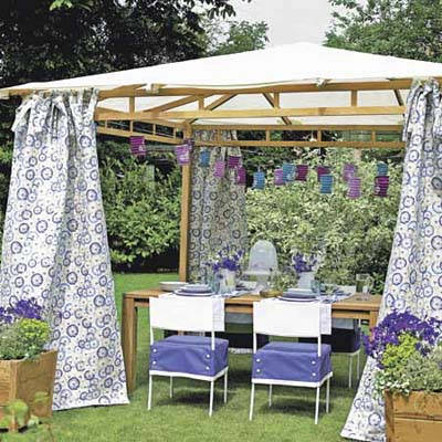 outdoor room with tented roof and fabric curtains