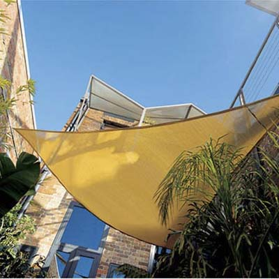 sail shade cools off patio