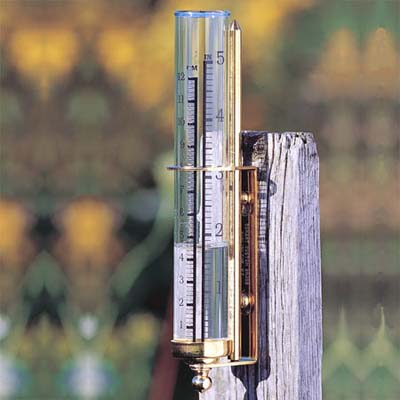 rainfall gauge attached to fence