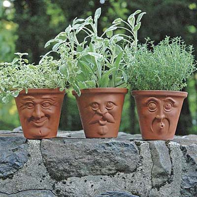 terracotta pots with molded faces