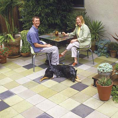man and woman sitting on multi-colored patio
