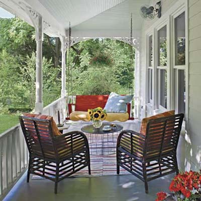 front porch with swing and outdoor pillows