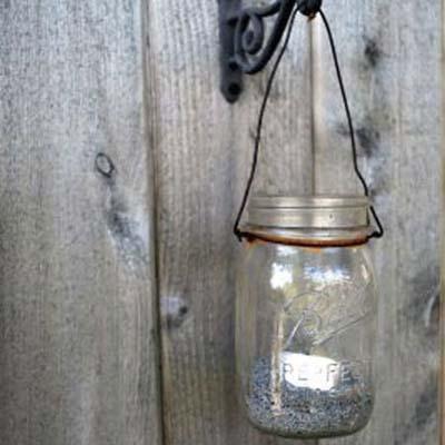 glass mason jar with tea light used as lantern