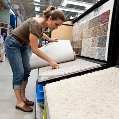 woman shopping for wall to wall carpet