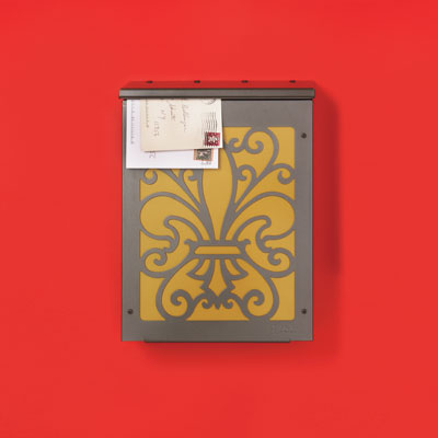 a galvanized steel painted wall-mount mailbox with a fleur-de-lis painted on the front