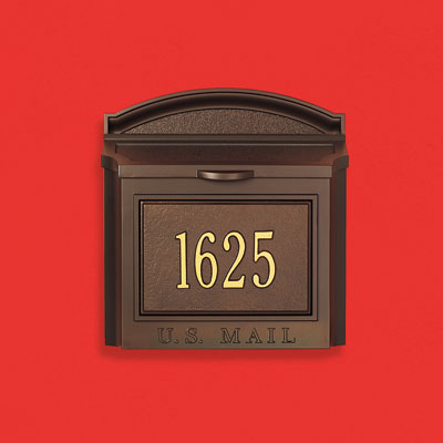 a powder-coated aluminum wall-mount mailbox with house numbers embossed on the front