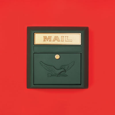 a dark green powder-coated aluminum wall-mount mailbox with an eagle embossed on the front