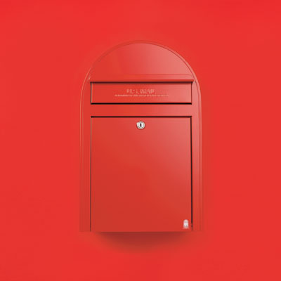 an oversized red zinc-plated steel wall-mount mailbox