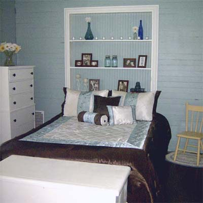 updated bedroom with blue painted walls