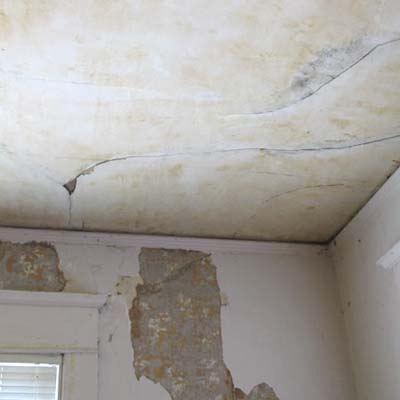 cracked and peeling ceiling and walls