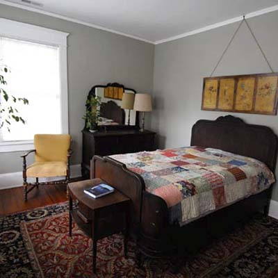 bedroom with gray walls and oriental rug