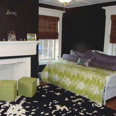 updated bedroom with black walls and white trim