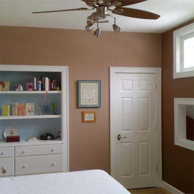 updated bedroom with built in shelves and ceiling fan