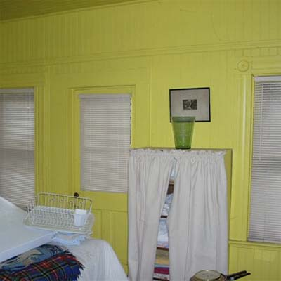 bedroom with bright yellow walls
