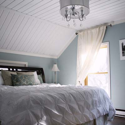 updated bedroom with sloped white ceiling and chandelier light fixture