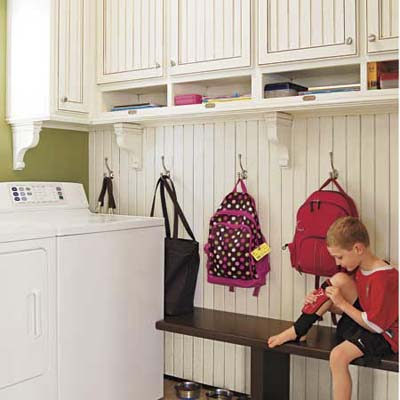 Child sitting in a remodeled mudroom