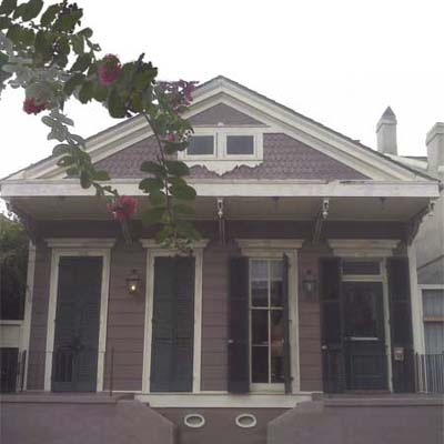 outdated purple victorian house exterior