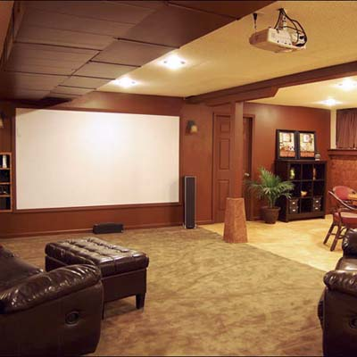 finished basement with projector screen