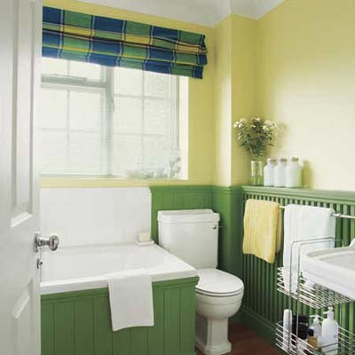 bathroom with bright green wainscoting