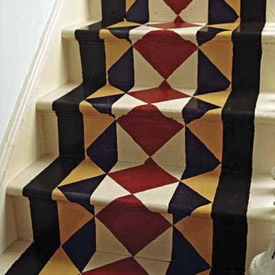 wood staircase with painted on stair runner