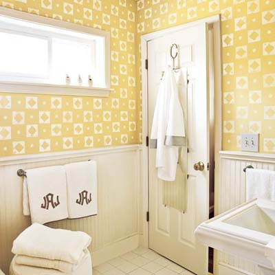 yellow bathroom walls with white stamp design