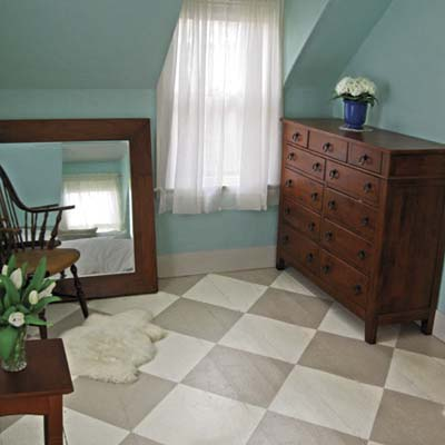 bedroom with painted checkered floor