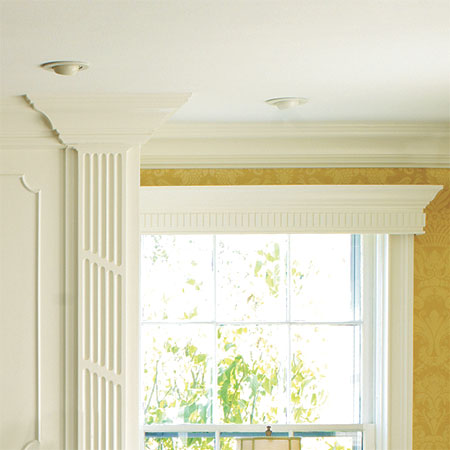 beefy crown molding gives definition to walls and ceilings in this greek revival remodel