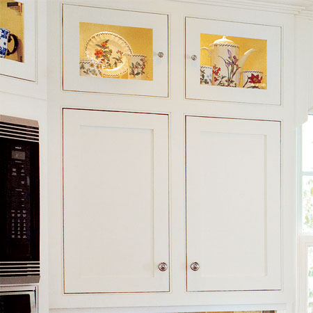 custom kitchen cabinets built by the homeowner in this remodeled greek revival