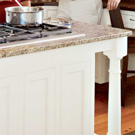granite topped kitchen island in this remodeled greek revival