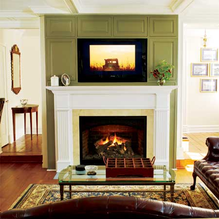 family room with gas fireplace in this remodeled greek revival